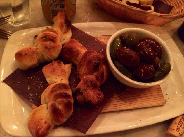 OLIVE CALDE E NODINI spicy, warm olives and soft, toasted bread  knots, garlic